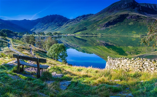 A bench overlooking the water in Lake District National Park