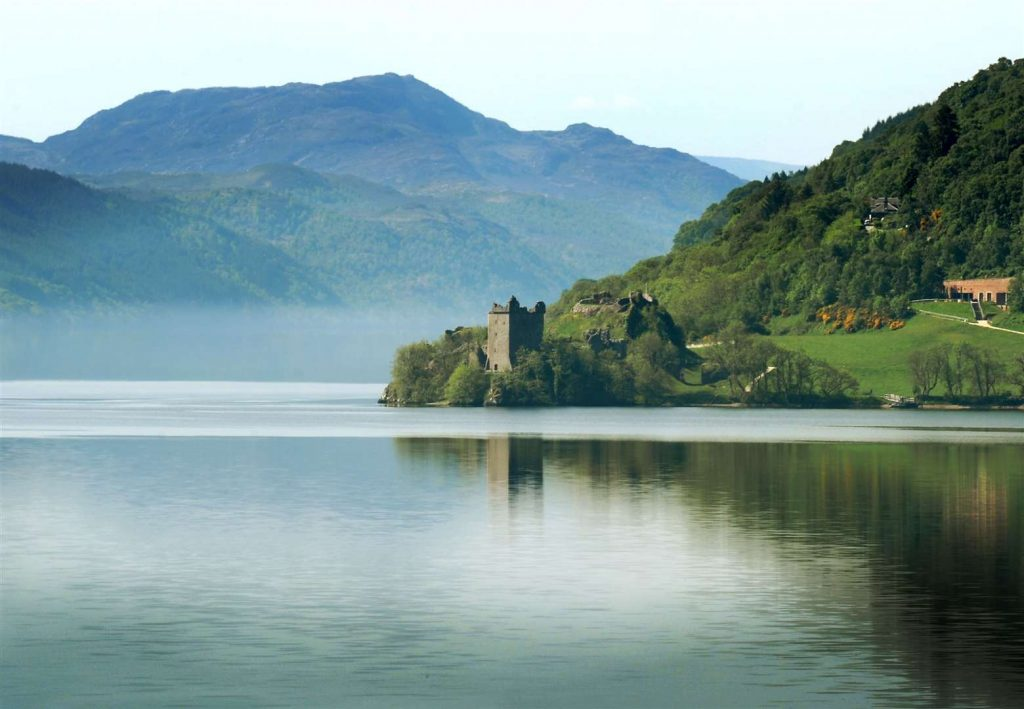 A tower on the edge of a crystal clear Loch Ness