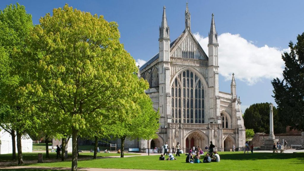People sitting in front of Winchester Cathedral