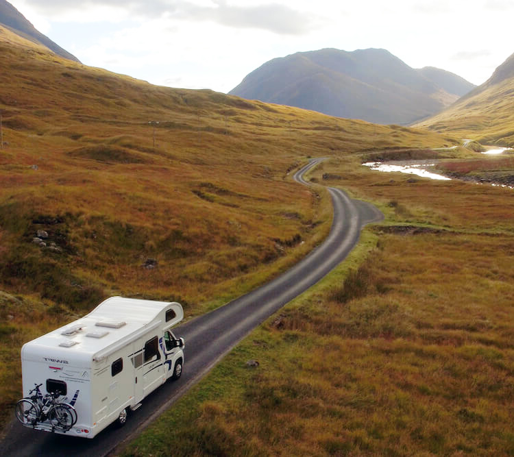 A DJ Motor Home Hire motorhome driving down hills